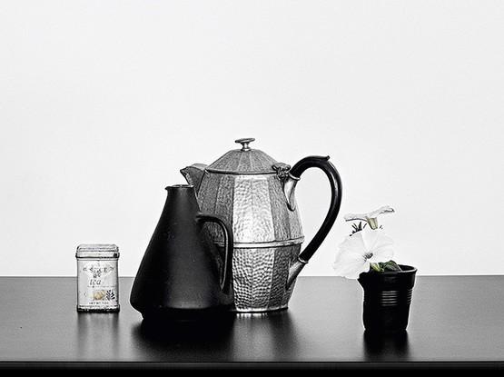 Teekanne mit Becher
